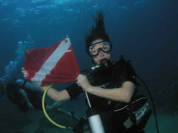 Open Water Scuba Referral Certification Diver In Maui Holding Dive Flag